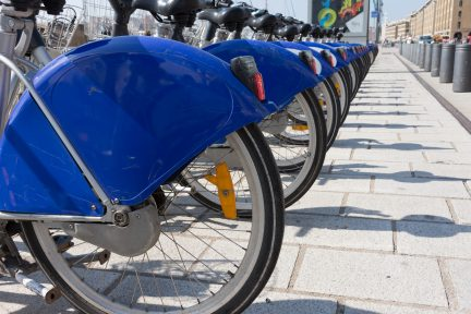 Close Up Of A Row Of Bicycles With Royal Blue And White Fenders To Rent In Vieux Port Or Old Port In