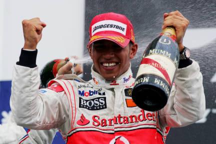 Race winner Lewis Hamilton (GBR) McLaren celebrates on the podium