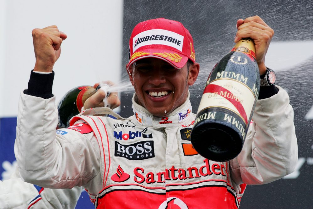 Race winner Lewis Hamilton (GBR) McLaren celebrates on the podium
