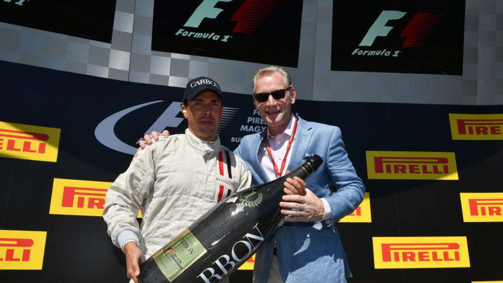 From left, Alexandre Mea, CEO of Champagne Carbon, and Sean	 Bratches, Managing Director, Commercial Operations, Formula 1, on the podium of the Formula 1 Pirelli Magyar Nagydij 2017