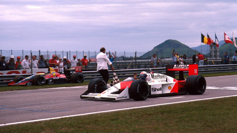 Alain Prost FRA McLaren MP44 Honda RA168-E takes the flag and the win  Brazilian Grand Prix Jacarepa.jpg