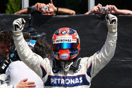 Robert Kubica (POL) BMW Sauber F1.08 celebrates his first GP win in parc ferme