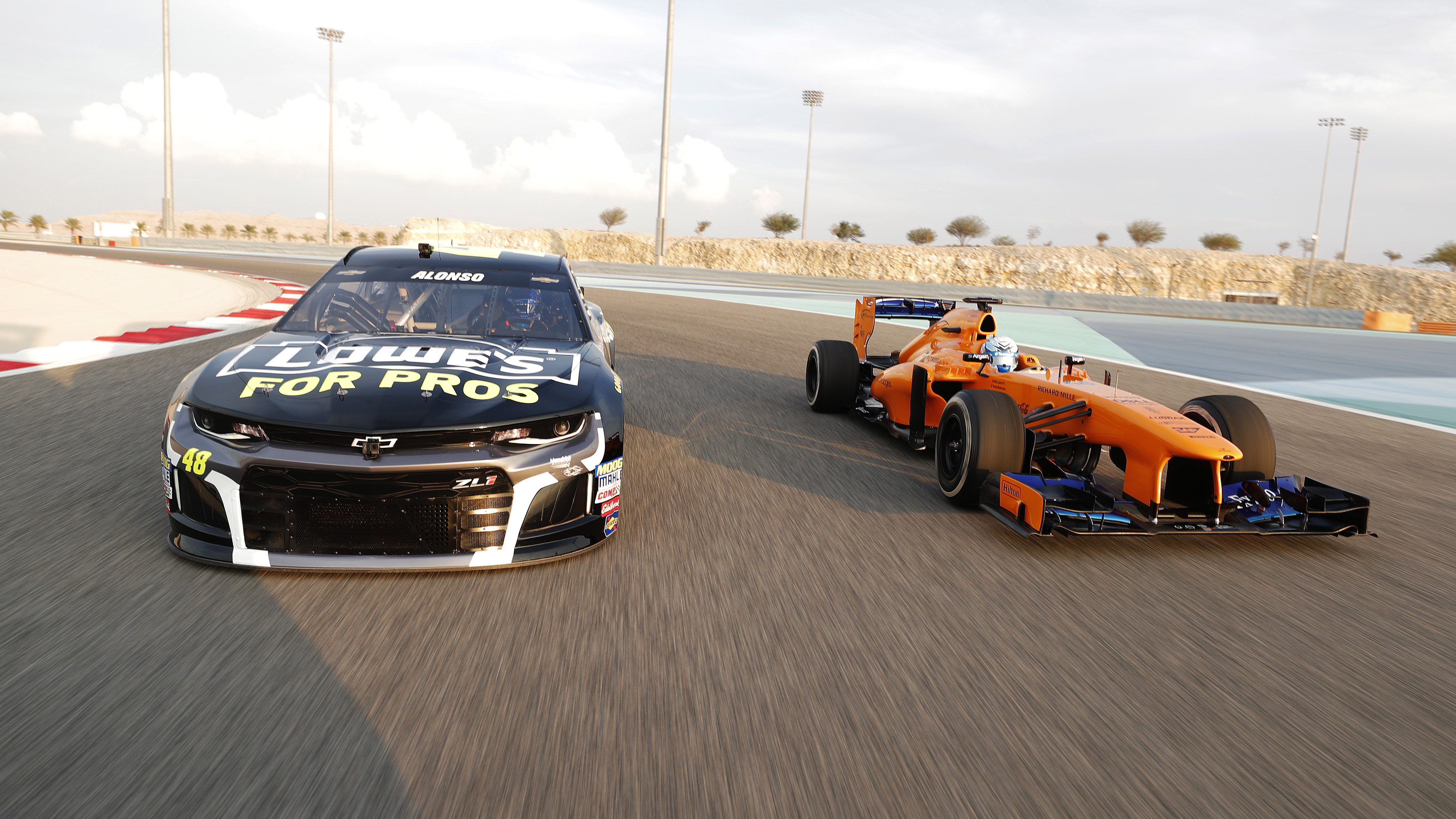 Fernando Alonso and NASCAR racer Jimmie Johnson seat swap