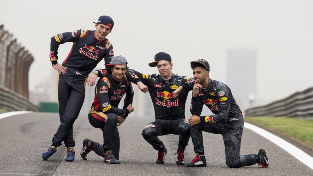 SHANGHAI, CHINA - APRIL 14:  Daniel Ricciardo of Australia and Red Bull Racing, Daniil Kvyat of Russia and Red Bull Racing, Carlos Sainz of Spain and Scuderia Toro Rosso and Max Verstappen of Netherlands and Scuderia Toro Rosso pose for a photo on the track during previews to the Formula One Grand Prix of China at Shanghai International Circuit on April 14, 2016 in Shanghai, China.