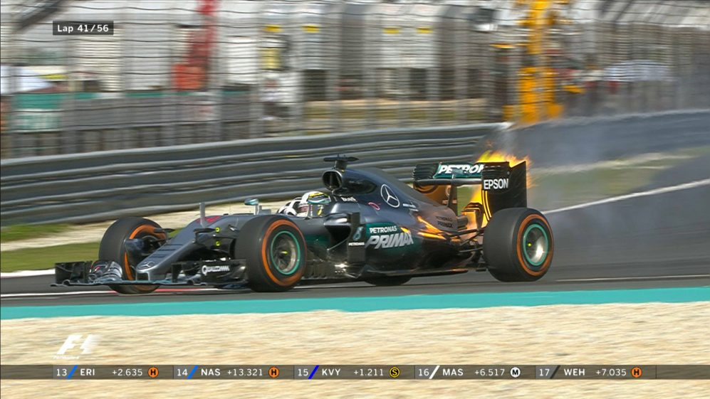 Race: Sepang hopes go up in flames for Hamilton