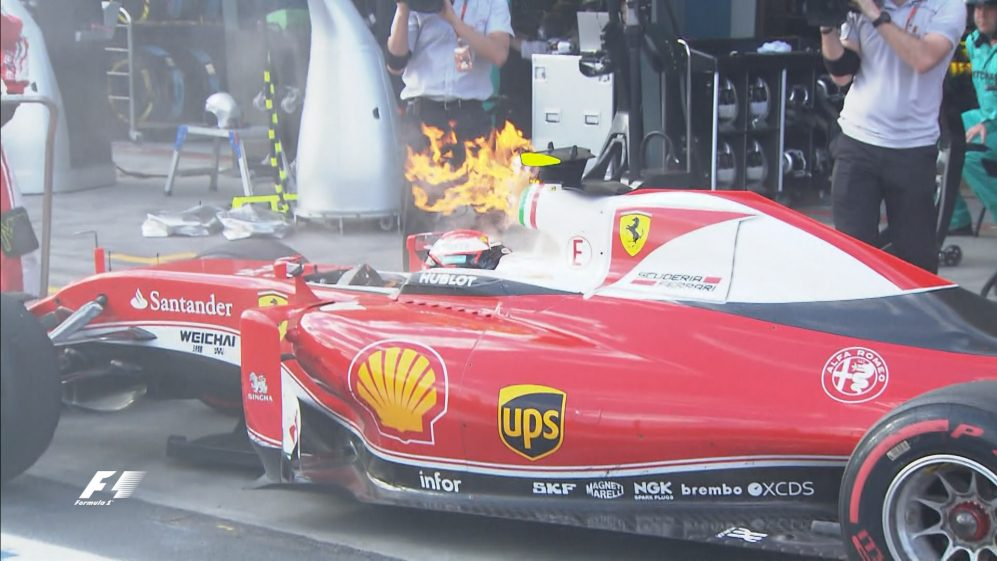 Race: Raikkonen retires with flames pouring from his Ferrari
