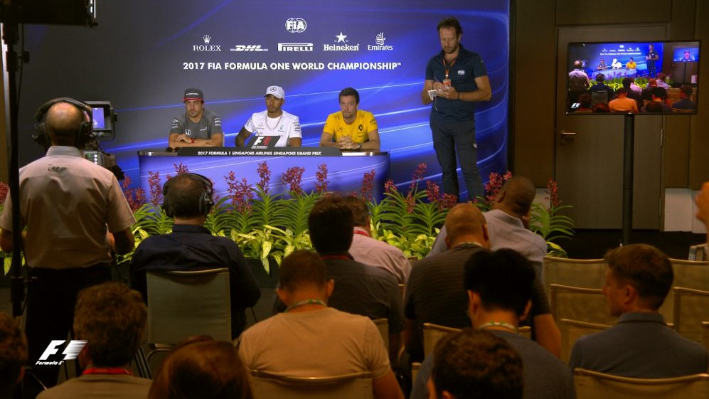 Drivers face the press in Singapore