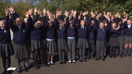 WELL DONE LEWIS: Pupils from Hamilton's former school celebrate 5th world title