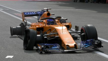 RACE: Alonso returns to pits on two wheels