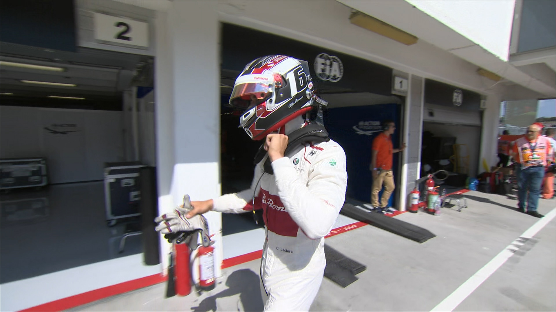 RACE: Leclerc out after squeeze between Force Indias