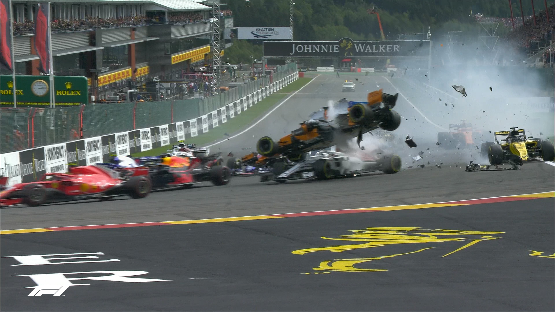 RACE: Alonso sent flying in spectacular first-corner crash