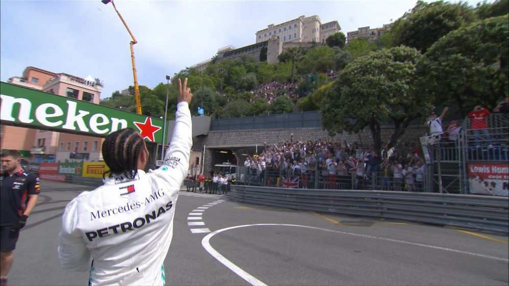 QUALIFYING: Delighted Hamilton leaps onto catch fence after taking Monaco pole