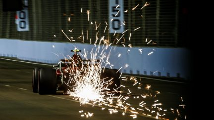 Hamilton snatches pole in Singapore