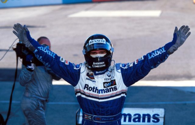 Race winner Damon Hill (GBR) Williams FW18 is able to celebrate his winning of the world Championship. Japanese Grand Prix, Suzuka, 13 October 1996. World © Sutton. © No reproduction without permission.