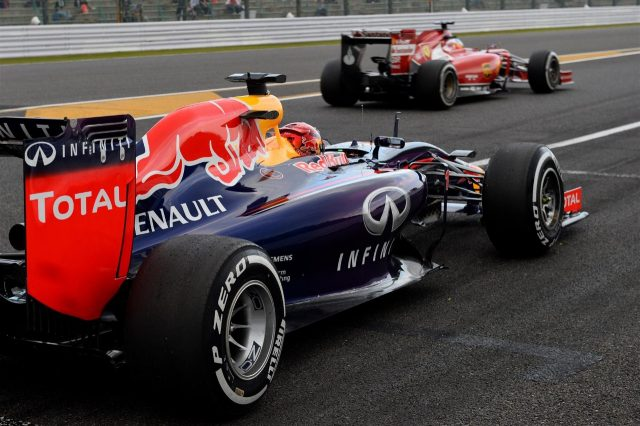 (L to R): Sebastian Vettel (GER) Red Bull Racing RB10 and Fernando Alonso (ESP) Ferrari F14 T. Formula One World Championship, Rd15, Japanese Grand Prix, Practice, Suzuka, Japan, Friday, 3 October 2014 © Sutton Images. No reproduction without permission