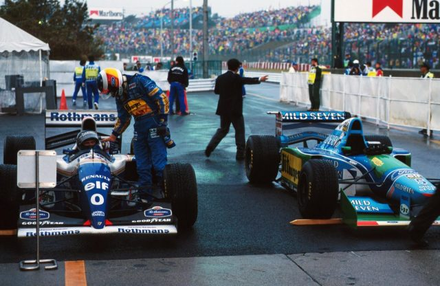 Damon Hill (Williams FW16B Renault) 1st position is congratulated by Michael Schumacher (Benetton Ford) who finished in 2nd position. 1994 Japanese Grand Prix. Suzuka, Japan. 6-8 November 1994. © Sutton Images