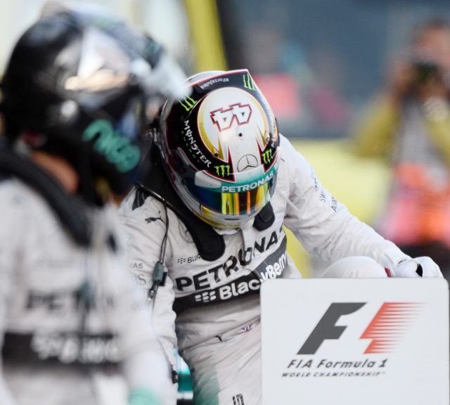 (L to R): Second placed Nico Rosberg (GER) Mercedes AMG F1 and race winner Lewis Hamilton (GBR) Mercedes AMG F1 in parc ferme. Formula One World Championship, Rd16, Russian Grand Prix, Race, Sochi Autodrom, Sochi, Krasnodar Krai, Russia, Sunday, 12 October 2014 © Sutton Images. No reproduction without permission