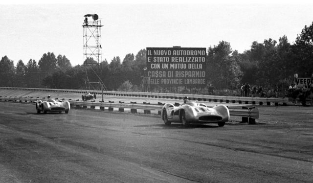 Winner Juan Manuel Fangio leads Stirling Moss (both stream-lined Mercedes-Benz W196) in front of the banking. Fangio finished in 1st position. 1955 Italian Grand Prix © LAT Photographic