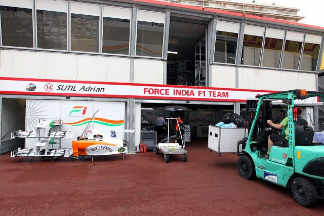 Freight is loaded into the Force India garage