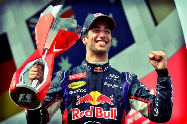 Race winner Daniel Ricciardo (AUS) Red Bull Racing celebrates on the podium with the trophy.