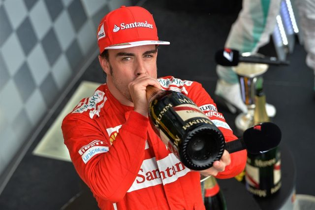 Second placed finisher Fernando Alonso (ESP) Ferrari drinks champagne On the podium. Formula One World Championship, Rd11, Hungarian Grand Prix, Race Day, Hungaroring, Hungary. Sunday, 27 July 2014 © Sutton Images. No reproduction without permission