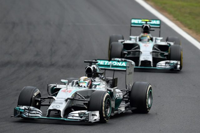 Lewis Hamilton (GBR) Mercedes AMG F1 W05 leads Nico Rosberg (GER) Mercedes AMG F1 W05. Formula One World Championship, Rd11, Hungarian Grand Prix, Race Day, Hungaroring, Hungary. Sunday, 27 July 2014 © Sutton Images. No reproduction without permission