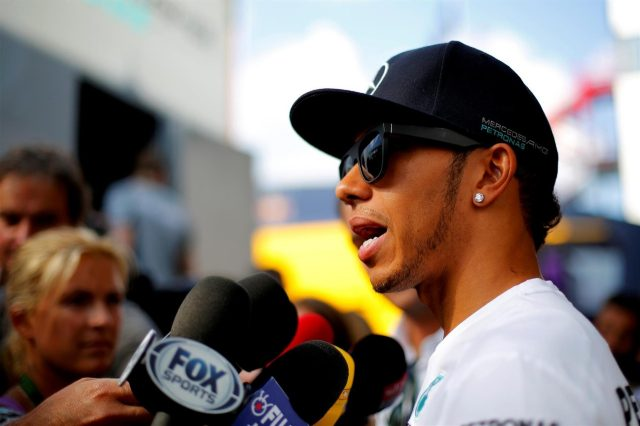 Lewis Hamilton (GBR) Mercedes AMG F1 is interviewed by the media. Formula One World Championship, Rd11, Hungarian Grand Prix, Preparations, Hungaroring, Hungary. Thursday, 24 July 2014 © Sutton Images. No reproduction without permission