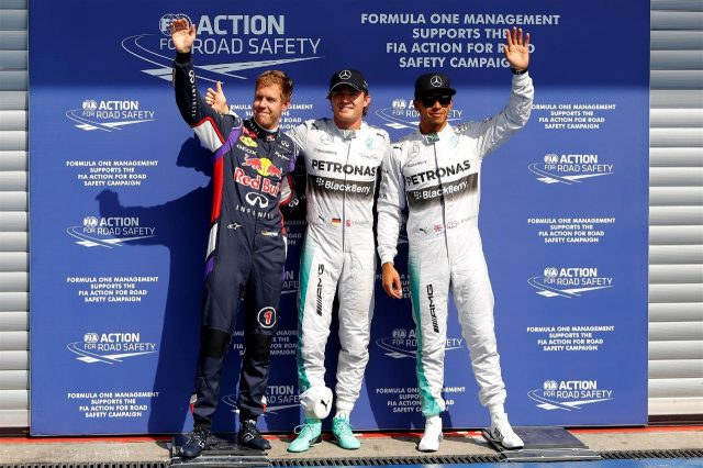 (L to R): Sebastian Vettel (GER) Red Bull Racing, pole sitter Nico Rosberg (GER) Mercedes AMG F1 and Lewis Hamilton (GBR) Mercedes AMG F1 celebrate in parc ferme. Formula One World Championship, Rd12, Belgian Grand Prix, Qualifying, Spa-Francorchamps, Belgium, Saturday, 23 August 2014 © Sutton Images. No reproduction without permission