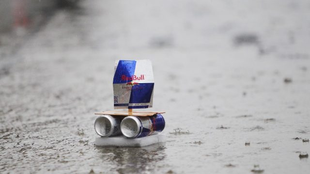A Red Bull boat sails down the pitlane during heavy rain. 