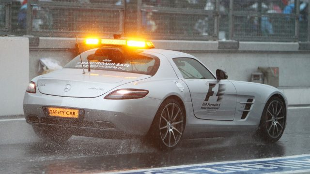 FIA Safety car inspects the wet circuit. 