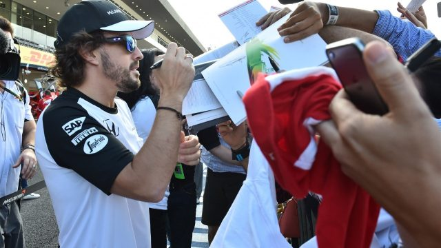 Fernando Alonso (ESP) McLaren with fans at the autograph session at Formula One World Championship, Rd17, Mexican Grand Prix, Preparations, Circuit Hermanos Rodriguez, Mexico City, Mexico, Thursday 29 October 2015. &copy&#x3b; Sutton Motorsport Images