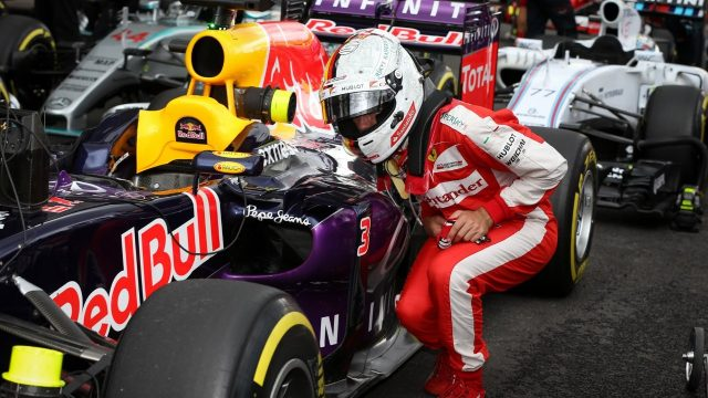 Sebastian Vettel (GER) Ferrari looks at the Red Bull Racing RB11 car at Formula One World Championship, Rd17, Mexican Grand Prix, Qualifying, Circuit Hermanos Rodriguez, Mexico City, Mexico, Saturday 31 October 2015. &copy&#x3b; Sutton Motorsport Images
