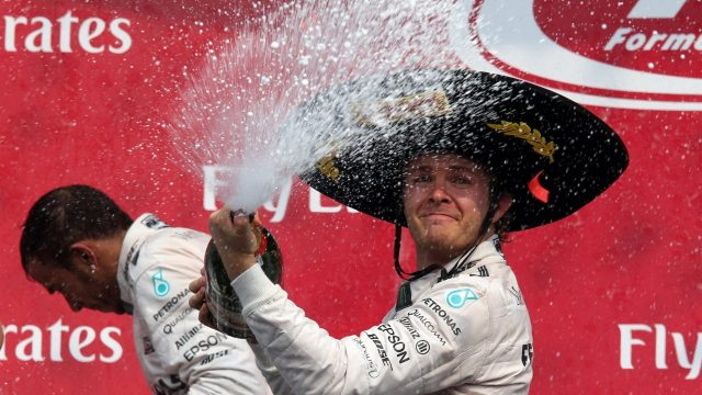 Lewis Hamilton (GBR) Mercedes AMG F1 and Race winner Nico Rosberg (GER) Mercedes AMG F1 celebrates with the champagne on the podium at Formula One World Championship, Rd17, Mexican Grand Prix, Race, Circuit Hermanos Rodriguez, Mexico City, Mexico, Sunday 1  November 2015. &copy&#x3b; Sutton Motorsport Images