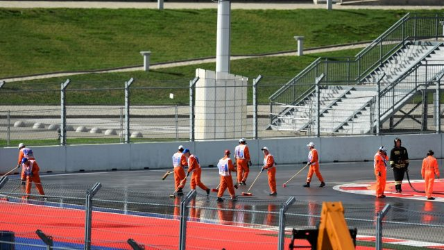 Marshals clean the track before FP1 at Formula One World Championship, Rd15, Russian Grand Prix, Practice, Sochi Autodrom, Sochi, Krasnodar Krai, Russia, Friday 9 October 2015. &copy&#x3b; Sutton Motorsport Images