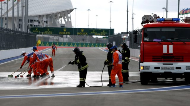 Marshals and Firemen clean the track at Formula One World Championship, Rd15, Russian Grand Prix, Practice, Sochi Autodrom, Sochi, Krasnodar Krai, Russia, Friday 9 October 2015. &copy&#x3b; Sutton Motorsport Images