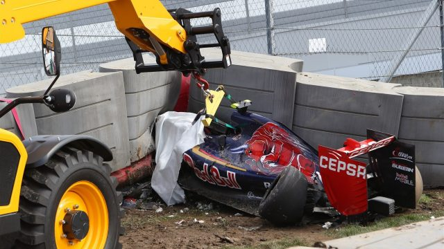 The crashed car of Carlos Sainz (ESP) Scuderia Toro Rosso is recovered from under the tech pro barrier in FP3 at Formula One World Championship, Rd15, Russian Grand Prix, Qualifying, Sochi Autodrom, Sochi, Krasnodar Krai, Russia, Saturday 10 October 2015. &copy&#x3b; Sutton Motorsport Images