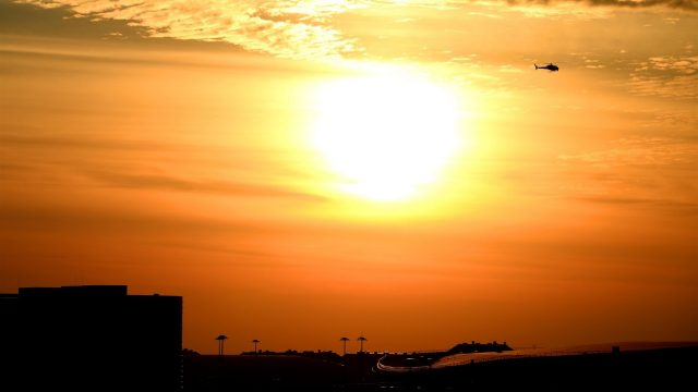 Sunset and helicopter at Formula One World Championship, Rd15, Russian Grand Prix, Qualifying, Sochi Autodrom, Sochi, Krasnodar Krai, Russia, Saturday 10 October 2015. &copy&#x3b; Sutton Motorsport Images