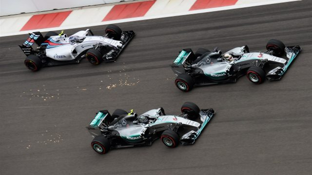 Lewis Hamilton (GBR) Mercedes AMG F1 W06 and Nico Rosberg (GER) Mercedes AMG F1 W06 battle for position at the start of the race at Formula One World Championship, Rd15, Russian Grand Prix, Race, Sochi Autodrom, Sochi, Krasnodar Krai, Russia, Sunday 11 October 2015. &copy&#x3b; Sutton Motorsport Images