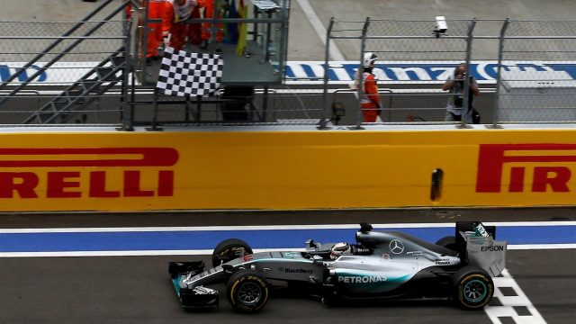 Race winner Lewis Hamilton (GBR) Mercedes AMG F1 W06 crosses the line and takes the chequered flag at Formula One World Championship, Rd15, Russian Grand Prix, Race, Sochi Autodrom, Sochi, Krasnodar Krai, Russia, Sunday 11 October 2015. &copy&#x3b; Sutton Motorsport Images
