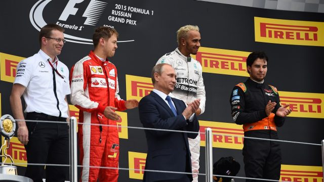 (L to R): Andy Cowell (GBR) Managing Director, Vladimir Putin (RUS), President of Russia, Sebastian Vettel (GER) Ferrari, race winner Lewis Hamilton (GBR) Mercedes AMG F1 and Sergio Perez (MEX) Force India celebrate on the podium at Formula One World Championship, Rd15, Russian Grand Prix, Race, Sochi Autodrom, Sochi, Krasnodar Krai, Russia, Sunday 11 October 2015. &copy&#x3b; Sutton Motorsport Images