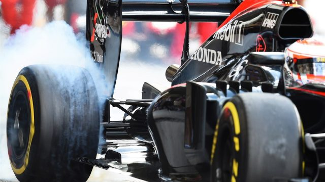 Jenson Button (GBR) McLaren MP4-30 and tyre smoke at Formula One World Championship, Rd19, Abu Dhabi Grand Prix, Practice, Yas Marina Circuit, Abu Dhabi, UAE, Friday 27 November 2015. &copy&#x3b; Sutton Motorsport Images