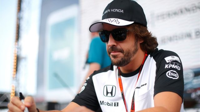 Fernando Alonso (ESP) McLaren at the autograph session at Formula One World Championship, Rd19, Abu Dhabi Grand Prix, Qualifying, Yas Marina Circuit, Abu Dhabi, UAE, Saturday 28 November 2015. &copy&#x3b; Sutton Motorsport Images
