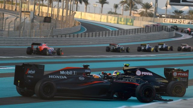 Pastor Maldonado (VEN) Lotus E23 Hybrid and Fernando Alonso (ESP) McLaren MP4-30 collide at the start of the race at Formula One World Championship, Rd19, Abu Dhabi Grand Prix, Race, Yas Marina Circuit, Abu Dhabi, UAE, Sunday 29 November 2015. &copy&#x3b; Sutton Motorsport Images