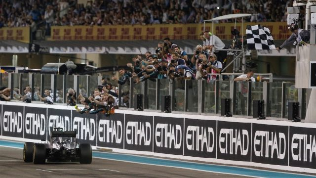 Race winner Nico Rosberg (GER) Mercedes AMG F1 W06 takes the chequered flag at Formula One World Championship, Rd19, Abu Dhabi Grand Prix, Race, Yas Marina Circuit, Abu Dhabi, UAE, Sunday 29 November 2015. &copy&#x3b; Sutton Motorsport Images