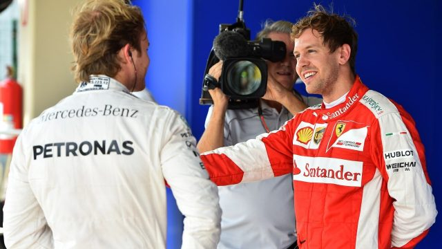 Pole sitter Nico Rosberg (GER) Mercedes AMG F1 and Sebastian Vettel (GER) Ferrari celebrate in parc ferme at Formula One World Championship, Rd18, Brazilian Grand Prix, Qualifying, Interlagos, Sao Paulo, Brazil, Saturday 14 November 2015. &copy&#x3b; Sutton Motorsport Images