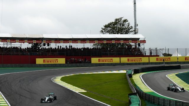 Nico Rosberg (GER) Mercedes AMG F1 W06 on track as Lewis Hamilton (GBR) Mercedes AMG F1 W06 exits pit lane at Formula One World Championship, Rd18, Brazilian Grand Prix, Race, Interlagos, Sao Paulo, Brazil, Sunday 15 November 2015. &copy&#x3b; Sutton Motorsport Images