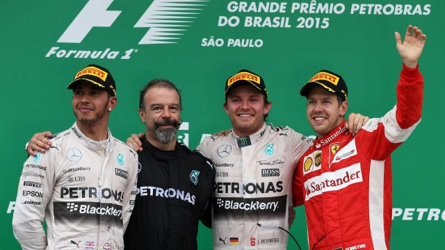 (L to R): Lewis Hamilton (GBR) Mercedes AMG F1, James Waddell (GBR) Mercedes AMG F1 Race Team Composite Techician, race winner Nico Rosberg (GER) Mercedes AMG F1 and Sebastian Vettel (GER) Ferrari celebrate on the podium at Formula One World Championship, Rd18, Brazilian Grand Prix, Race, Interlagos, Sao Paulo, Brazil, Sunday 15 November 2015. &copy&#x3b; Sutton Motorsport Images