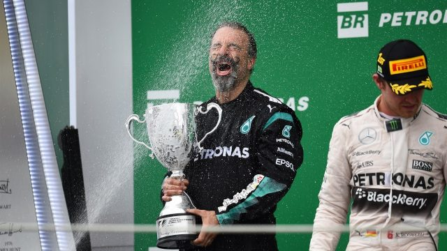 James Waddell (GBR) Mercedes AMG F1 Race Team Composite Technician celebrates with the Constructors trophy and the champagne on the podium at Formula One World Championship, Rd18, Brazilian Grand Prix, Race, Interlagos, Sao Paulo, Brazil, Sunday 15 November 2015. &copy&#x3b; Sutton Motorsport Images