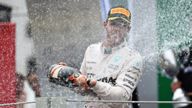 Lewis Hamilton (GBR) Mercedes AMG F1 celebrates on the podium with the champagne at Formula One World Championship, Rd18, Brazilian Grand Prix, Race, Interlagos, Sao Paulo, Brazil, Sunday 15 November 2015. &copy&#x3b; Sutton Motorsport Images