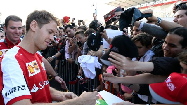 Sebastian Vettel (GER) Ferrari signs autographs for the fans at Formula One World Championship, Rd17, Mexican Grand Prix, Preparations, Circuit Hermanos Rodriguez, Mexico City, Mexico, Thursday 29 October 2015. &copy&#x3b; Sutton Motorsport Images